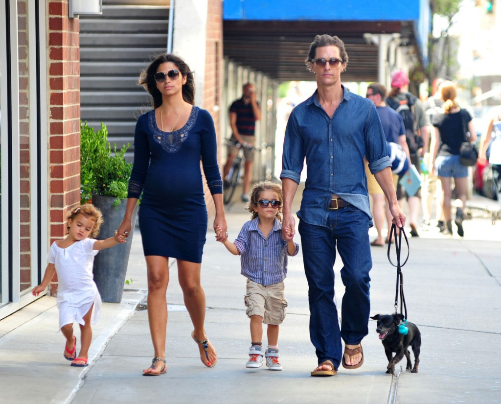 Matthew McConaughey holds hands with son Levi, pregnant wife Camila Alves, and daughter Vida as they walk their dog around New York City