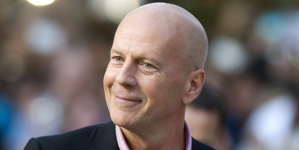 "Bruce Willis arrives at the gala presentation for the film ""Looper"" during the 37th Toronto International Film Festival"